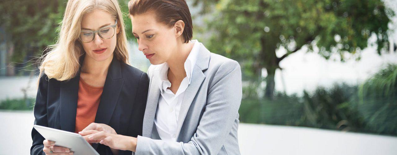 businesswoman-corporate-colleagues-talking-P3PSNFM